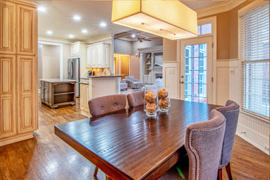 This picture shows light installation in Livermore. Beautiful chandelier and recessed lights in a kitchen and living room.