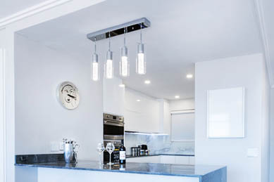 This picture shows track lighting installation in Livermore. Lights are in the kitchen above the kitchen island.